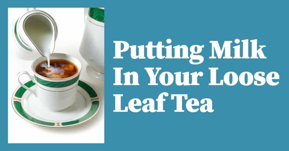 Someone pouring milk into a cup of loose leaf tea