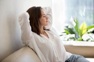 woman breathing fresh air while sitting
